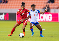 HOUSTON, TX - FEBRUARY 3: Aldrith Quintero #10 of Panama fights for the ball with Melchie Dumonay #6 of Haiti during a game between Panama and Haiti at BBVA Stadium on February 3, 2020 in Houston, Texas.