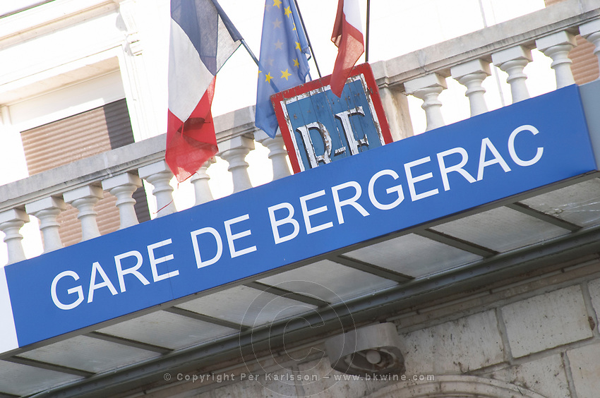 The Bergerac train station. Detail of the sign and the French flags. Bergerac Dordogne France