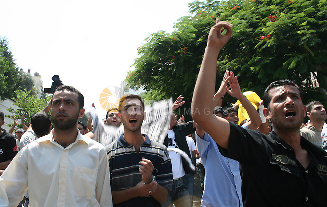 Palestinian Fatah party supporters shout as they take part in a rally following Friday noon prayers in Gaza City. More than 10,000 Palestinians have defied Hamas to pray outside in the biggest protest in the Gaza Strip since the radical Islamist movement captured control of the territory two months ago.