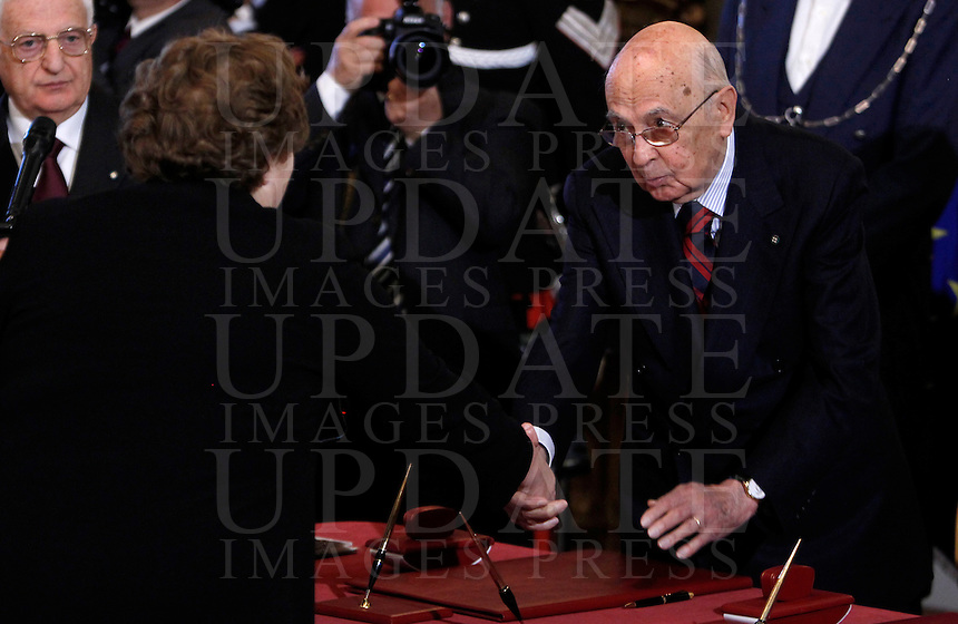 Il Ministro della Giustizia Anna Maria Cancellieri stringe la mano al Presidente della Repubblica Giorgio Napolitano, a destra, alla cerimonia del giuramento del nuovo governo al Quirinale, Roma, 28 aprile 2013..Italian Justice Minister Anna Maria Cancellieri shakes hands with Head of State Giorgio Napolitano, right, during the swearing in ceremony of the new government at the Quirinale presidential palace Rome, 28 April 2013..UPDATE IMAGES PRESS/Isabella Bonotto
