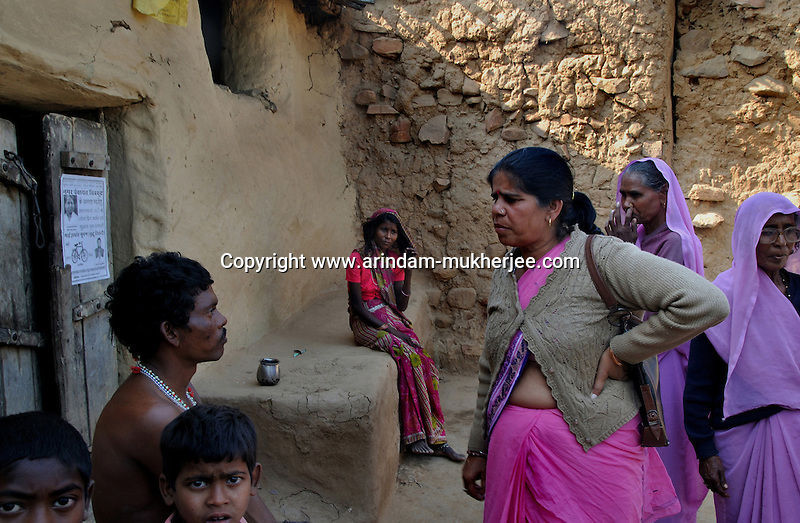 Sampat Pal talks to one of the Mawasi tribes in a very poor village at Chitrakoot District of Madhya Pradesh. Sampat pal Devi the commander of Gulabi Gang fights for women empowerment, justice and rights among the poor people of Bundelkhand region of Uttar Pradesh. Sampat Pal Devi comes from a poor family in Bundelkhand - the poorest region of India. The region is fraught with abject poverty, gross under development, lack of law and order, and stark casteism in which the Brahmins and other higher caste people treat their low caste brethren with disdain. Out of such situation when Sampat Pal Devi decided to speak up for the poor, she has been winning heart felt gratitude of the poor as well as enmity of the high caste people and grudging respect of the law enforcement officials who used to be largely inactive in these badlands of North India. Initially, she began with helping distressed women - victims of domestic violence and dowry system, but soon started getting other cases of nature of land dispute and under development. She emerged as a fiery leader in 2007, when she beat up the OC of the local police station while demanding release of a dalit woman kept locked up in the cell for thirteen days without being charged with a case.Today, she has a huge fan following of some 25 hundreds of thousands of women (spread across 8 districts of the state of UP) who have come to be known as Gulabi Gang or Pink Vigilante Women for their vibrant pink sarees - the costume of the gang; and fiery nature of dealing with injustice. When verbal negotiations for justice fail they resort to beating up. Sampat Devi is viewed as a messiah with the promise of bringing back law and order for the poor, in these mafia troubled areas. Today, perpetrators are simply scared of her as she does not hesitate to challenge law and order and even system - to win justice for the poor. More complaints related to domestic violence and other problems are registered now with the police than they ever use