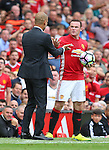 Josep Guardiola manager of Manchester City keeps the ball from Wayne Rooney of Manchester United during the Premier League match at Old Trafford Stadium, Manchester. Picture date: September 10th, 2016. Pic Simon Bellis/Sportimage