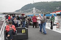 Participants enjoy a boat ride on river Danube with Gellert Hill in the background during the International Day for Older Persons in Budapest, Hungary on Oct. 1, 2018. ATTILA VOLGYI