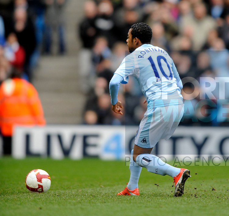 Manchester City's Robinho is too clever for his own good as he checks his run up and misses his penalty.