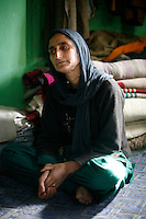 Fatima Begum,35,  had to switch roles from a housewife to lone breadwinner of her family when her husband crossed the Line of Control to Pakistan Administered Kashmir to get arms training. After a year, her husband become deputy commander of a militant outfit, Al-Barq and came to be known as Amjad Khan. ?When he was returning home the troops laid an ambush and fired upon him. He engaged them in a fierce gun battle was a finally martyred on November 13, 1992,? Fatima said. .Dardpora, Kashmir, India. © Fredrik Naumann/Felix Features