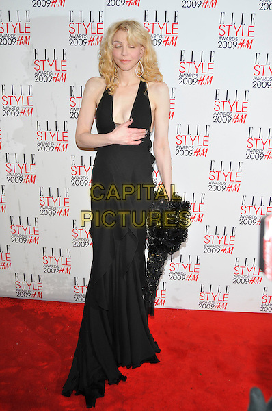 COURTNEY LOVE .Attending the Elle Style Awards 2009,  Big Sky London, London, England, February 9th 2009..arrivals full length black dress pale skin wavy hair halterneck long maxi hand layered .CAP/PL.©Phil Loftus/Capital Pictures