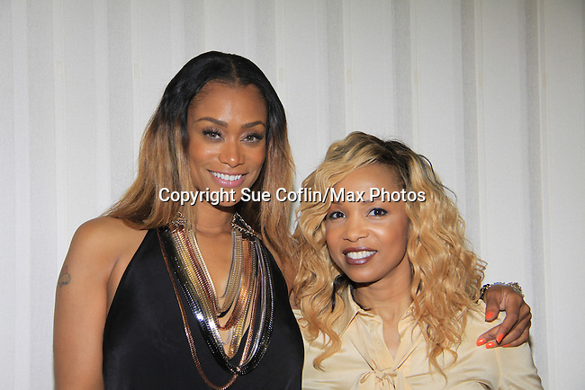 Jennifer Williams (walking in fashion show) poses with Tami Roman (L) both Basketball Wives at Samantha Black Fashion Show - NYC Fashion Week - September 7, 2013 - New York City, NY (Photo by Sue Coflin/Max Photos)