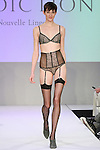 Model walks runway in lingerie from Addiction Nouvelle, during the Lingerie Fashion Night - Romancing The Runway show, by CurvExpo and Lycra on February 23, 2015.