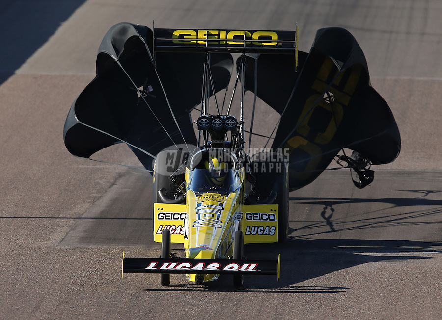 Feb. 23, 2013; Chandler, AZ, USA; NHRA top fuel dragster driver Morgan Lucas during qualifying for the Arizona Nationals at Firebird International Raceway. Mandatory Credit: Mark J. Rebilas-