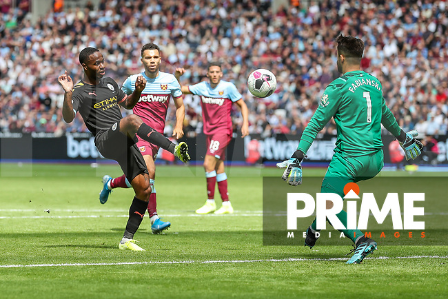 GOAL - Raheem Sterling of Manchester City scores his team's third goal during the Premier League match between West Ham United and Manchester City at the London Stadium, London, England on 10 August 2019. Photo by David Horn.