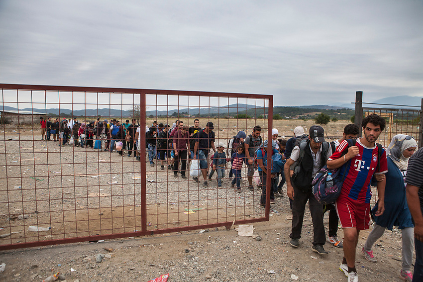 Refugees entering the UNHCR registration centre in Gevgeliya, Macedonia. SAt the centre, refugees received travel documents allowing them to travel legally through Macedonia. Refugees at Gevgelija Border Crossing Macedonian Side.