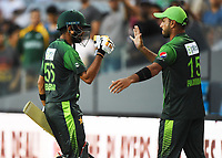 Babar Azam is congratulated on his 50 not out by Rumman Raees.<br /> Pakistan tour of New Zealand. T20 Series.2nd Twenty20 international cricket match, Eden Park, Auckland, New Zealand. Thursday 25 January 2018. &copy; Copyright Photo: Andrew Cornaga / www.Photosport.nz
