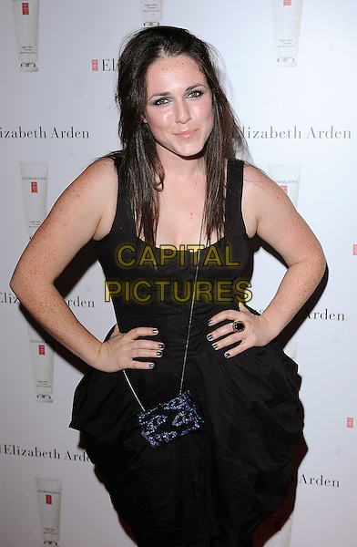 SANDI THOM .attending The Elizabeth Arden Eight Hour Party at 24 Kingly Street, London,.England, 7th August 2008.full length black dress hands on hips puffy bag.CAP/BEL.©Tom Belcher/Capital Pictures