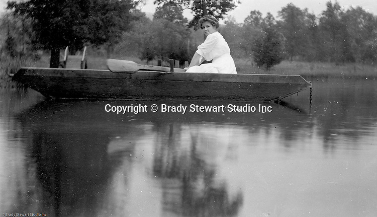 Faytette County:  Helen Stewart in row boat on Youghiogheny Lake. Stewart family went on vacation to Stewart Township to visit family.