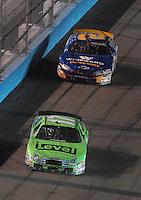 Apr 20, 2007; Avondale, AZ, USA; Nascar Busch Series driver Matt Kenseth (17) leads Clint Bowyer (2) during the Bashas Supermarkets 200 at Phoenix International Raceway. Mandatory Credit: Mark J. Rebilas