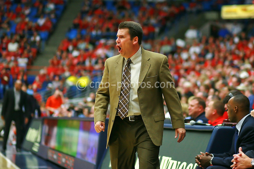 Jan 10, 2009; Tucson, AZ, USA; Arizona Wildcats interim head coach Russ Pennell yells at his team in the second half of a game against the Oregon State Beavers at the McKale Center.  The Wildcats won the game 64-47.