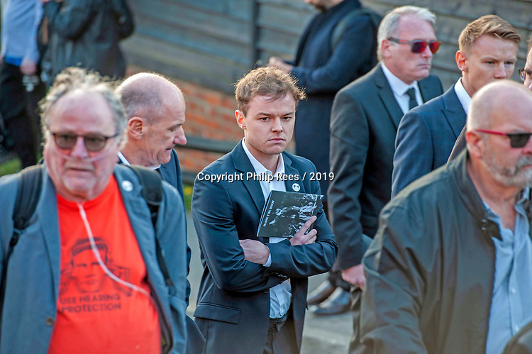Mourners leaving the service after the funeral of the late Prodigy singer Keith Flint at St Marys Church in Bocking,  Essex today.
