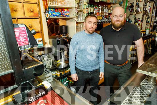Patrick McCarthy and Paul O'Sullivan behind the bar of Paddy Mac's pub on Sunday