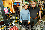 Patrick McCarthy and Paul O'Sullivan behind the bar of Paddy Mac's pub on Sunday