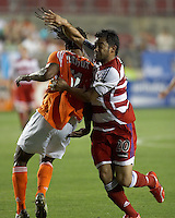 Houston Dynamo's Adrian Serioux (51) and FC Dallas' Carlos Ruiz (20) battle for the ball at Robertson Stadium in Houston, TX on Saturday May 6, 2006. The Houston Dynamo defeated FC Dallas 4-3.