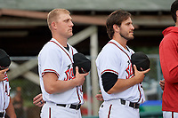 Richmond Flying Squirrels relief pitchers Chase Johnson (left) and (right during the national anthem before an Eastern League game against the Binghamton Rumble Ponies on May 29, 2019 at The Diamond in Richmond, Virginia.  Binghamton defeated Richmond 9-5 in ten innings.  (Mike Janes/Four Seam Images)