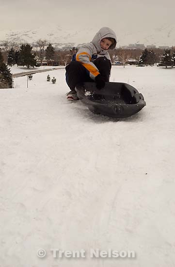 Noah Nelson sledding at Sugarhouse park<br />