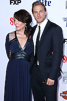HOLLYWOOD, LOS ANGELES, CA, USA - SEPTEMBER 06: Actress Katey Sagal and actor Charlie Hunnam arrive at the Los Angeles Premiere Of FX's 'Sons Of Anarchy' Season 7 held at the TCL Chinese Theatre on September 6, 2014 in Hollywood, Los Angeles, California, United States. (Photo by Xavier Collin/Celebrity Monitor)