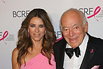 "Elizabeth Hurley and Leonard Lauder attend The Breast Cancer Research Foundation ""Super Nova"" Hot Pink Party on May 12, 2017 at the Park Avenue Armory in New York City."