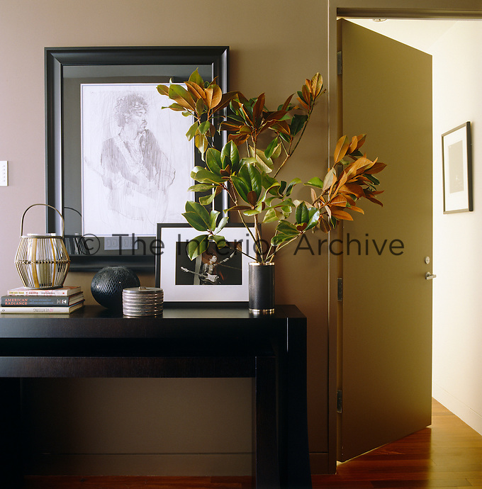 With a framed portrait taking pride of place the console table in the entrance hall has become a shrine to Jimi Hendrix