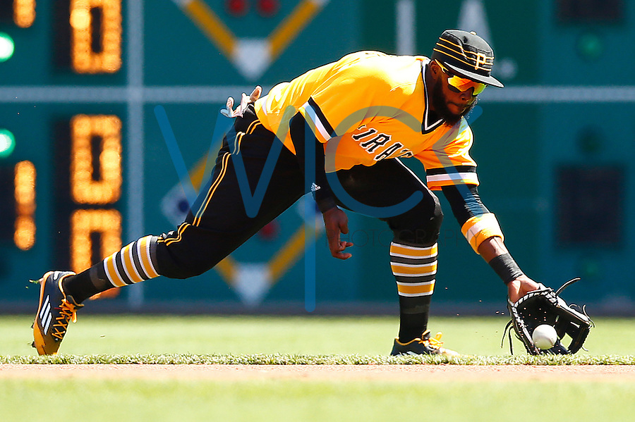 Josh Harrison #5 of the Pittsburgh Pirates grabs a ground ball against the Milwaukee Brewers during the game at PNC Park in Pittsburgh, Pennsylvania on April 17, 2016. (Photo by Jared Wickerham / DKPS)