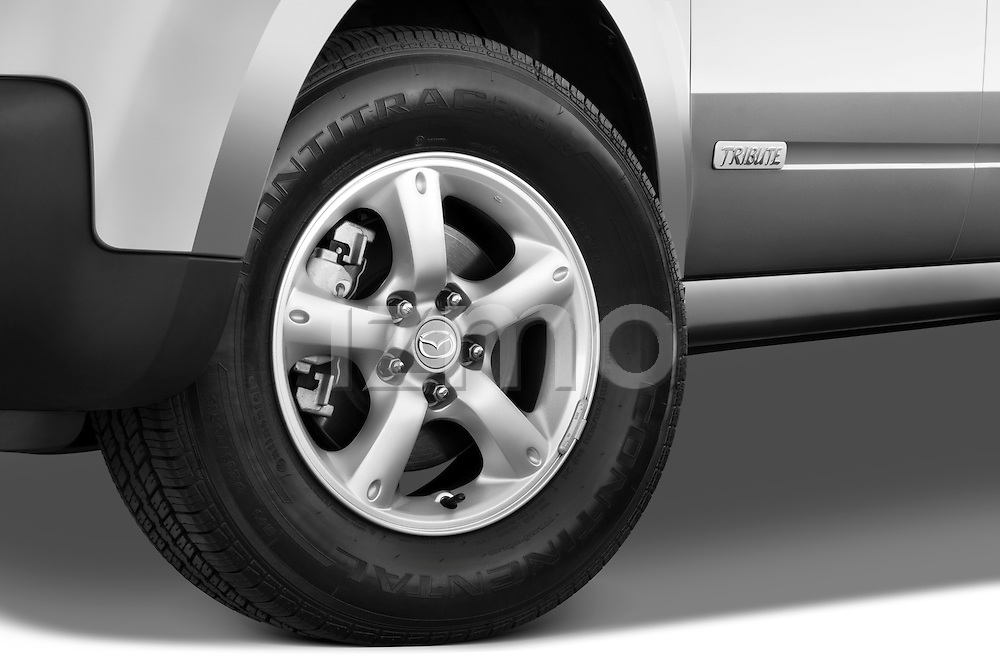 Tire and wheel close up detail view of a 2009 Mazda Tribute Hybrid