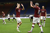 Alexis Saelemaekers of AC Milan celebrates with Theo Hernandez after scoring a goal during the Serie A football match between AC Milan and Bologna FC at stadio Giuseppe Meazza in Milano ( Italy ), July 18th, 2020. Play resumes behind closed doors following the outbreak of the coronavirus disease. <br /> Photo Image Sport / Insidefoto