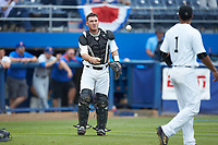 Wake Forest Demon Deacons catcher Ben Breazeale (39) flips the ball to relief pitcher Donnie Sellers (1) during the game against the Florida Gators in the completion of Game Two of the Gainesville Super Regional of the 2017 College World Series at Alfred McKethan Stadium at Perry Field on June 12, 2017 in Gainesville, Florida. The Demon Deacons walked off the Gators 8-6 in 11 innings. (Brian Westerholt/Four Seam Images)
