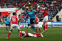Cian Bolger of Fleetwood Town loses the ball to Michael Smith of Rotherham United during the Sky Bet League 1 match between Rotherham United and Fleetwood Town at the New York Stadium, Rotherham, England on 7 April 2018. Photo by Leila Coker.