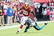 Landover, MD - October 14, 2018: Washington Redskins running back Adrian Peterson (26) breaks Carolina Panthers free safety Mike Adams (29) tackle during the  game between Carolina Panthers and Washington Redskins at FedEx Field in Landover, MD.   (Photo by Elliott Brown/Media Images International)