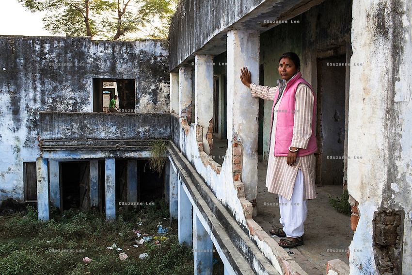 Santwana Manju of Guria poses for a photograph in the deserted building of one of the largest of the ten brothels that Guria had raided and seized in the Shivdaspur red light area in 2005 rescuing 57 underaged girls, and jailing 39 perpetrators, in Varanasi, Uttar Pradesh, India on 22 November 2013. The facade of the building is minimalistic and unsuspicious, but the rear of the building opens into a sprawling honeycomb of cubicles both on ground level and underground.