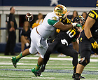 Oct. 5, 2013; Stephon Tuitt (7) forces a fumble in the Shamrock Series game against Arizona State.<br /> <br /> Photo by Matt Cashore