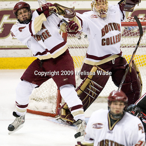 Carl Sneep (Boston College - 7), John Muse (Boston College - 1) - The Boston College Eagles defeated the Northeastern University Huskies 4-1 on senior night at Kelley Rink at Conte Forum in Chestnut Hill, Massachusetts, on Saturday, March 7, 2009.