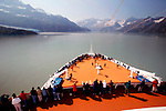Cruise ship passengers line the deck as they approach Glacier Bay, Alaska.