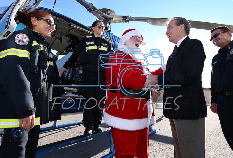 Carson City Mayor Bob Crowell welcomes Santa to the 10th annual Holiday with a Hero event at Walmart in Carson City, Nev., on Wednesday, Dec. 17, 2014. <br /> Photo by Cathleen Allison