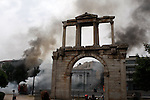 Hadrian's Arch and Acropolis in the background. Athens in chaos. Protesters clashed with the police burnt buildings and cars. Demonstration against the new austerity measures in central athens.