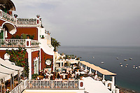 The La Sponda restaurant divides into a series of terraces overlooking the coast in Positano, Italy