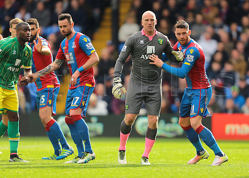 09.04.2016. Selhurst Park, London, England. Barclays Premier League. Crystal Palace versus Norwich. Norwich City Goalkeeper John Ruddy joins the Norwich attack during a corner, and jostles with Crystal Palace Forward Connor Wickham