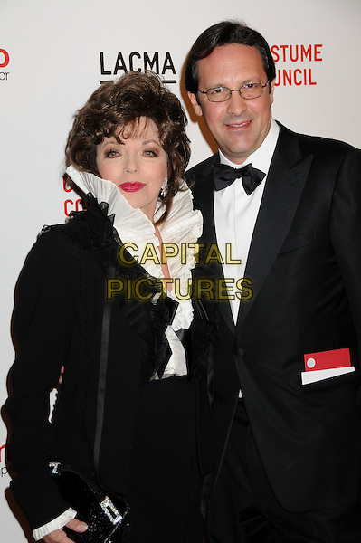 "JOAN COLLINS & PERCY GIBSON.""Valentino: The Last Emperor"" Los Angeles Premiere held at LACMA, Los Angeles, CA, USA..April 1st, 2009.half length black skirt jacket white ruffled ruffles blouse tuxedo bow tie glasses married husband wife .CAP/ADM/BP.©Byron Purvis/AdMedia/Capital Pictures."