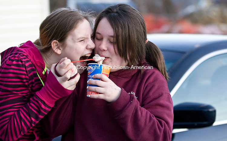 WINSTED, CT - 18 MARCH 2010 -031810JT01-<br /> Cecilia Hill, 12, tries to muscle her way to a bite of ice cream from her best friend Solveigh Driscoll, 13, at the Dairy Queen in Winsted on Thursday.<br /> Josalee Thrift Republican-American