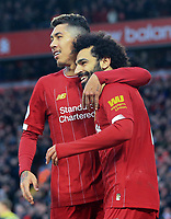 1st February 2020; Anfield, Liverpool, Merseyside, England; English Premier League Football, Liverpool versus Southampton; Mohammed Salah of Liverpool celebrates with team mate Roberto Firmino after scoring his side's third goal