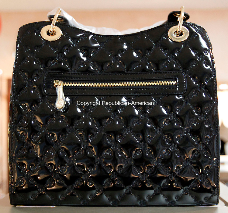 Southbury, CT- 18 June 2013-061813CM02-  A leather Italian designer handbag by Rioni valued at 525 dollars was a raffle prize donated by the Jewelry Cafe in Southbury Tuesday afternoon. The raffle was a benefit for the Southbury Women's Club, with the proceeds from the ticket sales going towards helping area charities. Stella Trzaski, of Glen Allen, VA won the raffle. 160 tickets were sold, and 800 dollars was raised for the Women's Club. Christopher Massa Republican-American