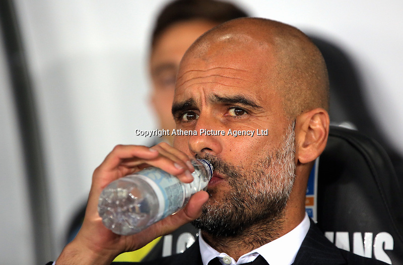 Manager of Manchester City, Pep Guardiola drinks water prior to the EFL Cup Third Round match between Swansea City and Manchester City at The Liberty Stadium in Swansea, Wales, UK. Wednesday 21 September.