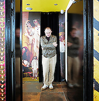 Designer Christian Lacroix stands at the entrance to the lounge at Le Bellechasse Hotel in Paris