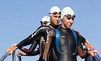 28 JUN 2012 - LONDON, GBR - Liz Blatchford leads the competitors onto the pontoon for the start of the elite women's 2012 Canary Wharf Triathlon heat in Canary Wharf, London, Great Britain .(PHOTO (C) 2012 NIGEL FARROW)